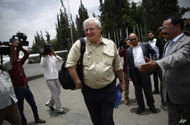 Stephen O'Brien, under-secretary-general and emergency relief coordinator for the United Nations Office for the Coordination of Humanitarian Affairs, leaves the Sanaa airport after a press conference in Sanaa, Yemen, Tuesday, Aug. 11, 2015.