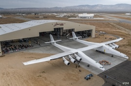 "The ""Roc"" plane is seen outside its hangar. (Stratolaunch)"