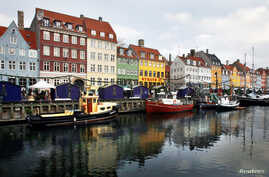 FILE - Boats are anchored in the Nyhavn district of Copenhagen, Denmark, Dec. 5, 2009. Global watchdog Transparency International said  Wednesday its latest annual Corruption Perceptions Index report Denmark and New Zealand performed best in 2016, wi