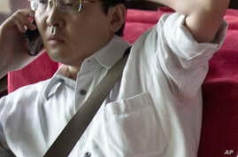 FILE - Attorney Xia Lin, pictured on July 14, 2011, was sentenced to 12 years in prison, Sept. 22, 2016, on fraud charges in what observers said was thought to be the harshest penalty rendered in years against those few willing to take on the ruling