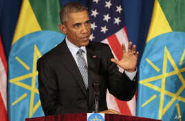 U.S. President Barack Obama gestures during a joint press conference with Ethiopian Prime Minister Hailemariam Desalegn at the National Palace in Addis Ababa, Ethiopia, July 27, 2015.