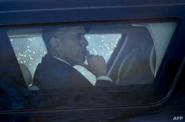 FILE - US President Barack Obama is seen in an armored vehicle.
