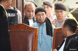 Islamic cleric Aman Abdurrahman arrives at a court ahead of his verdict in Jakarta, Indonesia, June 22, 2018, in this photo taken by Antara Foto.