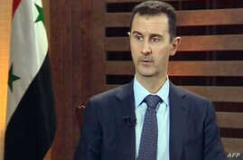 A grab from Addounia pro-regime Syrian TV shows Syrian President Bashar al-Assad speaking during an excerpt of an interview in Damascus, August 29, 2012.