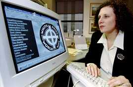 FILE - The Stormfront website is seen on a computer at the Anti-Defamation League's Boston offices.