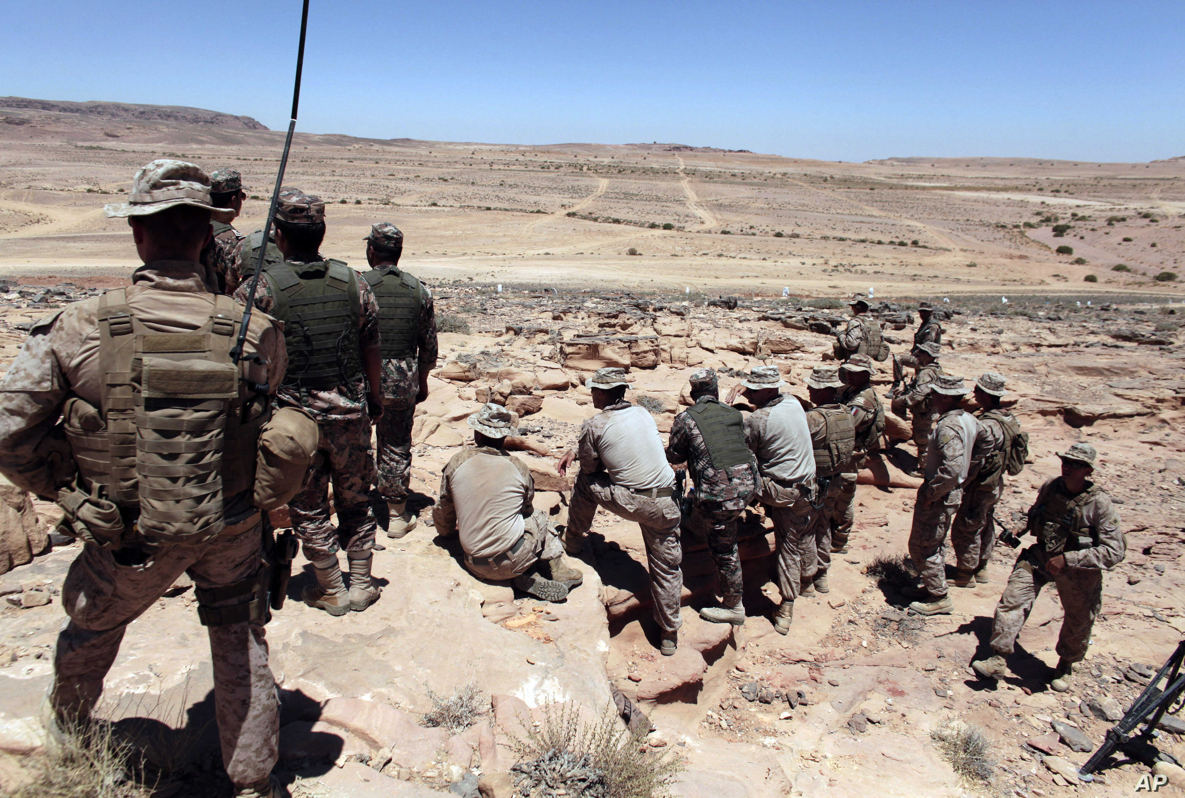 FILE - U.S. Marines monitor Eager Lion multinational military maneuvers in Quweira, 186 miles south of Amman, Jordan, June 18, 2013. The Obama administration used U.S. military trainers to help increase the capabilities of the Syrian rebels.