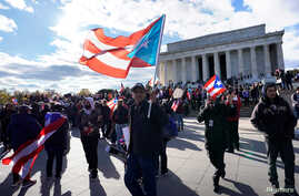 Members of the Hispanic Federation participate in the Unity March to highlight the ongoing humanitarian and natural disaster crisis in Puerto Rico, at the Lincoln Memorial in Washington, Nov. 19, 2017.