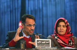 Ahmad Fahim Hakim, left, a member of the Afghan People's Dialogue on Peace Initiative addresses a press conference in Kabul, Afghanistan, Saturday, Jan. 9, 2016. Afghanistan, Pakistan, China and the United States will hold talks in Islamabad on Monda