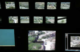 FILE - Screens for surveillance cameras show various points along the border between Nogales, Mexico, and Nogales, Ariz., in a U.S. Border Patrol station in Nogales, Ariz.