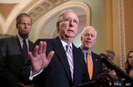FILE - Senate Majority Leader Mitch McConnell, R-Kentucky, flanked by Sen. John Thune, R-South Dakota, left, and Majority Whip John Cornyn, R-Texas, speaks with reporters about Supreme Court nominee Brett Kavanaugh at the Capitol in Washington, Sept.