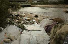 Garbage lies on the banks of a river flowing into the Mediterranean Sea in Dbayeh, north of the Lebanese capital Beirut, on 16 Mar 16, 2010