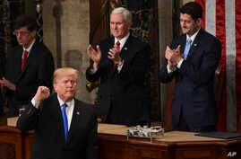President Donald Trump gestures at the end of his State of the Union address to a joint session of Congress on Capitol Hill in Washington, Tuesday, Jan. 30, 2018.