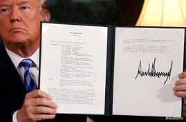 U.S. President Donald Trump holds a proclamation declaring his intention to withdraw from the JCPOA Iran nuclear agreement after signing it in the Diplomatic Room at the White House in Washington, May 8, 2018.