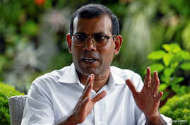 FILE - Former Maldives President Mohamed Nasheed speaks during an interview in Colombo, Sri Lanka, June 4, 2018. He said June 29 that he would step aside as MDP presidential candidate after the national election commission ruled him ineligible to run