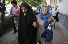 FILE - Mary Rezaian, mother of detained Washington Post correspondent Jason Rezaian, right, and Jason's wife Yeganeh leave a Revolutionary Court building in Tehran, Iran, Aug. 10, 2015.