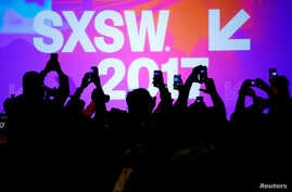 Audience members use their mobile phones to take photographs of former U.S. Vice-President Joe Biden at the South by Southwest (SXSW) Music Film Interactive Festival 2017 in Austin, Texas, March 12, 2017.