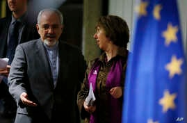 Iranian minister Mohammad Javad Zarif, left, and European Union foreign policy chief Catherine Ashton, Geneva, Nov. 10, 2013.