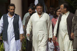 Pakistan's former President and head of the All Pakistan Muslim League political party, Pervez Musharraf (C), arrives with party leaders to unveil his party manifesto for the forthcoming general election, at his residence in Islamabad, April 15, 2013