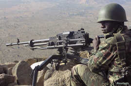A Cameroonian soldier guards at an observation post on a hill in the Mandara Mountain chain in Mabass overlooking Nigeria, northern Cameroon, February 16, 2015. Boko Haram militants kidnapped some 80 people from the village on January 18, according t