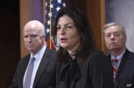Senate Armed Service Committee member Sen. Kelly Ayotte, R-N.H., center, flanked by committee chairman Sen. John McCain, R-Ariz., left, and fellow committee member Sen. Lindsey Graham, R-S.C., speaks during a news conference on Capitol Hill in Washin...