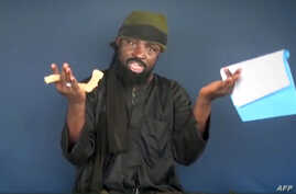 This screen grab image taken on February 18, 2015 from a video made available by Islamist group Boko Haram shows Boko Haram leader Abubakar Shekau making a statement at an undisclosed location.