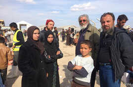 The family of Ammar Hazzin (3rd from L) says their flight from New Mosul was delayed after 21 people were executed by IS militants for attempting escape on March 26, 2017 in Hammam Alil, Iraq. (H.Murdock/VOA)