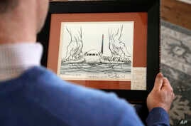 In this Jan. 10, 2019 photo, Steve O'Brien holds an editorial cartoon framed with his boarding pass from US Airways Flight 1549 that eventually crash-landed in the Hudson River on Jan. 19, 2009 as he poses for a photo at his home in Charlotte, N.C.