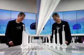 Hansjoerg Reick looks at a display of Oral-B Genius X smart toothbrushes at the Procter & Gamble booth before CES International, Monday, Jan. 7, 2019, in Las Vegas.