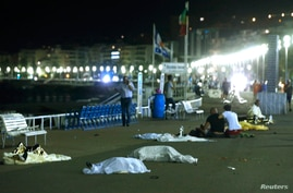 Bodies are seen on the ground, July 15, 2016, after at least 30 people were killed in Nice, France, when a truck ran into a crowd celebrating the Bastille Day national holiday, July 14, 2016.