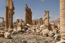 This photo released pm March 28, 2016, by the Syrian official news agency SANA, shows some damage at the ancient ruins of Palmyra, central Syria.