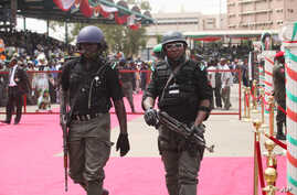 Nigerian police provide security during the ruling party's final campaign rally, at Eagle Square in  Abuja, Nigeria, March 26, 2011.