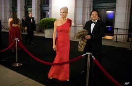 FILE - President-elect Donald Trump adviser Kellyanne Conway, accompanied by her husband, George, speaks with members of the media, Jan. 19, 2017, as they arrive for a dinner at Union Station in Washington, the day before Trump's inauguration.