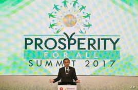 """FILE - Thailand's PM Prayuth Chan-ocha gestures during his speech at the """"Prosperity For All"""" Summit, the parallel event of the 30th ASEAN Leaders' Summit at metropolitan Manila, Philippines, April 28, 2017."""