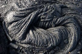 FILE - Hardened lava rock from Kilauea, an active volcano on Hawaii's Big Island, is shown in Volcanoes National Park near Kalapana, Hawaii, in this Aug. 8, 2016. photo.