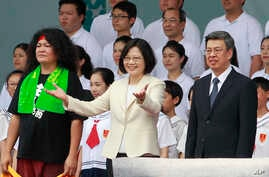 New Taiwan's President Tsai Ing-wen, center, and Vice President Chen Chien-jen, right, attend their inauguration ceremonies in Taipei, Taiwan, Friday, May 20, 2016.