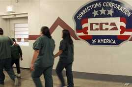 Immigrant detainees walk halls of the T. Don Hutto Residential Center, a Corrections Corporation of America immigration facility in Taylor, Texas, Feb. 9, 2007.