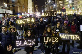 Protesters demonstrate in Lower Manhattan in New York City, demanding justice for the death of Eric Garner, Dec. 4, 2014.