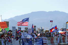 Protesters line one side of a roadway leading to Sunnylands where U.S. President Obama prepares to host leaders from Southeast Asia at the ASEAN Summit in Rancho Mirage, California, Feb. 15, 2016.