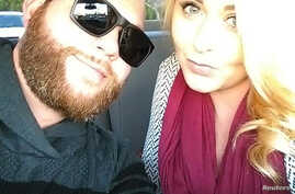 Christopher Roybal, left, is seen with his wife, Dixie Roybal, in this undated social media photo obtained by Reuters, Oct. 3, 2017.