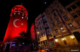 A Turkish flag is projected on the historical Galata Tower in tribute to the victims of Saturday's blasts in Istanbul, Turkey, December 12, 2016.