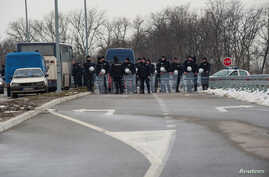 Police guard the road to the Kovilovo sport center hosting the handball match between Serbia and Kosovo, in Belgrade, Serbia, March 23, 2018. The match was later called off.