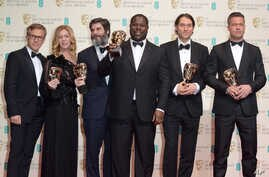 From left, Christoph Waltz, Dede Gardner, Anthony Katagas, Steve McQueen, Jeremy Kleiner and Brad Pitt pose with their awards for best film for 12 Years A Slave in the winners room at the EE British Academy Film Awards held at the Royal Opera House o