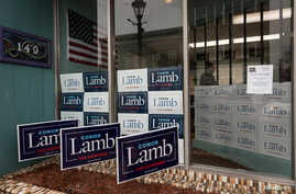 Signs adorn the entrance to Congressional candidate Conor Lamb's headquarters at 149 East High Street in Waynesburg, Pennsylvania, Feb. 14, 2018.