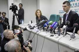 Mikhail Prokhorov, right, one of Russia's richest tycoons and New Jersey Nets basketball team owner, speaks at a press conference in Moscow, to announces his candidacy to run against Russian PM Vladimir Putin in the March 2012 presidential election,