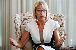 Education Secretary Betsy DeVos is interviewed in her office at the Education Department in Washington, Aug. 9, 2017.