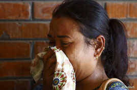 A relative cries as she arrives at a hospital in Kathmandu, where loved ones are undergoing treatment after being rescued from a landslide in northeast Nepal, August 2, 2014.