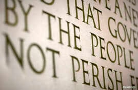 """FILE - A line from Abraham Lincoln's """"Gettysburg Address"""" is displayed at the Lincoln Memorial in Washington."""