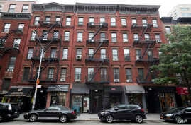 This photo shows 331, left, 333, center, and 335 East 9th Street in East Village neighborhood of New York, Aug. 31, 2018. The Kushner family real estate firm, which owns these buildings and others, has amassed more than half a million dollars in unpa