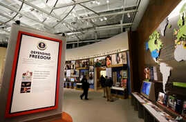 Displays on presidential policy are seen during a tour of the George W. Bush Presidential Center in Dallas, Texas, April 24, 2013.