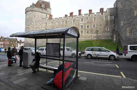 A sleeping bag and possessions of a homeless person are seen in a bus shelter opposite Windsor Castle in Windsor, Britain, Jan. 4, 2018.